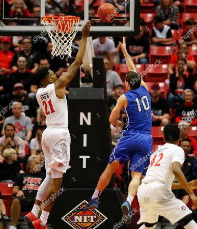 Max Landis, Malik Pope IPFW guard Max Landis drives for a basket against San Diego State forward Malik Pope in the first half of a NIT opening round NCAA college basketball game, in San Diego