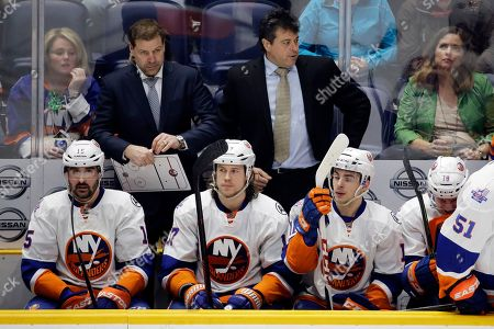 Jack Capuano, Doug Weight New York Islanders head coach Jack Capuano, top right, and assistant coach Doug Weight, top left, watch the action in the third period of an NHL hockey game against the Nashville Predators, in Nashville, Tenn. The Predators won 4-2