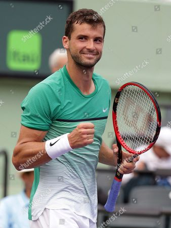 Stock Photo of Andy Murray, Grigor Dimitrov Grigor Dimitrov, of Bulgaria, pumps his fist after defeating Andy Murray at the Miami Open tennis tournament, in Key Biscayne, Fla. Dimitrov won 6-7 (1), 6-4, 6-3