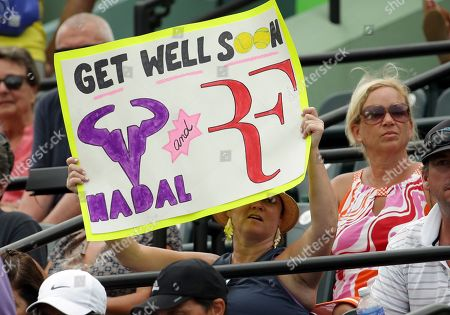 Andy Murray, Grigor Dimitrov A fan holds a sign referring to players Rafael Nadal and Roger Ferderer, who both withdrew early in the tournament at the Miami Open tennis tournament, in Key Biscayne, Fla. Dimitrov won 6-7 (1), 6-4, 6-3