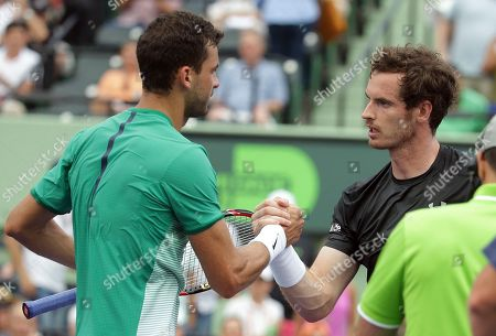 Andy Murray, Grigor Dimitrov Andy Murray, of Great Britain, right, shakes hands with Grigor Dimitrov, of Bulgaria, left, after their match at the Miami Open tennis tournament, in Key Biscayne, Fla. Dimitrov won 6-7 (1), 6-4, 6-3