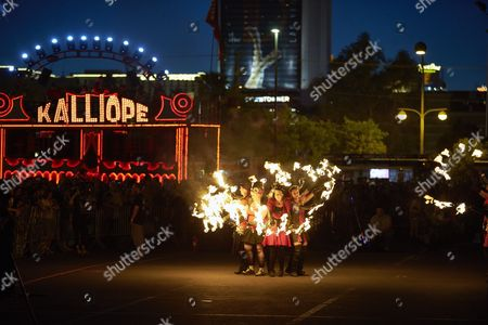 Performers dance with fire before the controlled burn of the Life Cube, in Las Vegas. Artist Scott Cohen created the project, a 24-foot build-and-burn art installation, over the course of several weeks before burning it down