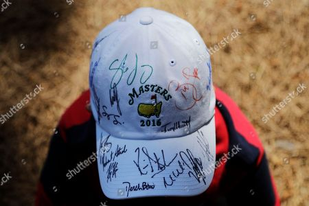 Stock Image of Eleven-year-old Charlie Miller shows off his autographed Masters' cap during a practice round for the Masters golf tournament, in Augusta, Ga