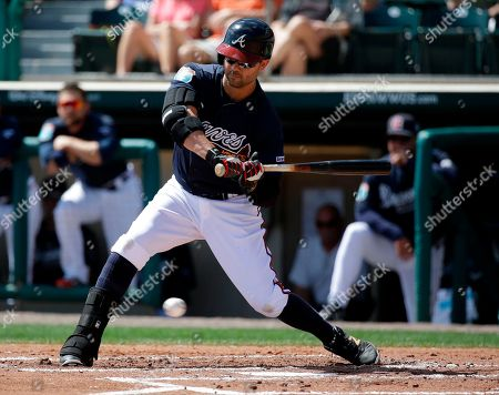 Atlanta Braves' Nick Swisher takes a pitch during a spring training baseball game against the New York Mets, in Kissimmee, Fla