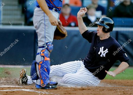 Chase Headley New York Yankees' Chase Headley slides home on an RBI single by Didi Gregorius off New York Mets starting pitcher Steven Matz during the second inning of a spring training baseball game, in Tampa, Fla