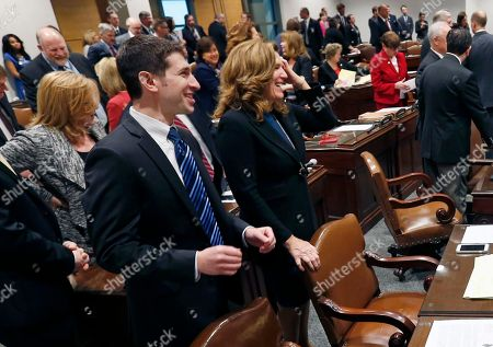 Jeremy Miller, Julie Rosen Republican Senators Jeremy Miller, left, and Julie Rosen, enjoy a laugh as the 2016 legislative session got underway, in St. Paul, Minn. The Senate is meeting in the new State Senate Building as the State Capitol undergoes restoration