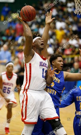 DeMikal Chesser, Matt Dale Forest's DeMikal Chesser (13) tries a shot at the basket while Kemper County's Matt Dale (32) defends in the MHSAA Boys Class 3A Championship basketball game in Jackson, Miss., . Kemper County won 54-50