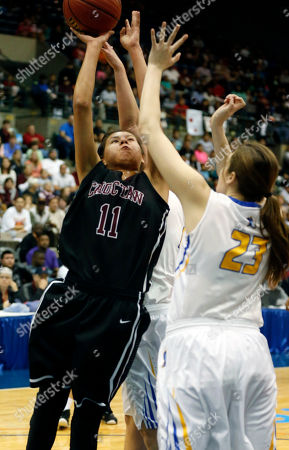 Melody Jimmie, Elly Nash Choctaw Central's Melody Jimmie (11) shoots at the basket past the defense of Booneville's Elly Nash (23) in the MHSAA Girls Class 3A Championship basketball game in Jackson, Miss