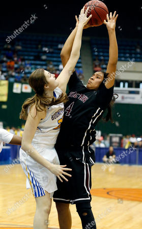 Kaedre Denson, Elly Nash Choctaw Central's Kaedre Denson (4) shot at the basket is blocked by Booneville's Elly Nash (23) in the MHSAA Girls Class 3A Championship basketball game in Jackson, Miss