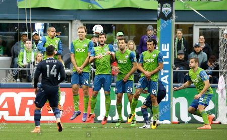 Brad Evans A Seattle Sounders wall (from left) of Osvaldo Alonso, Chad Marshall (14), Brad Evans (3), Andreas Ivanschitz (23), Nelson Valdez (16), and Jordan Morris (13) tries to block a free kick taken by Sporting Kansas City midfielder Graham Zusi (not shown) in the first half of an MLS soccer match, in Seattle