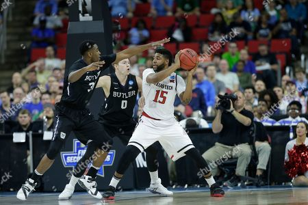 Texas Tech forward Aaron Ross (15) works against Butler forward Austin Etherington (0) during the second half of a first-round men's college basketball game in the NCAA Tournament, in Raleigh, N.C