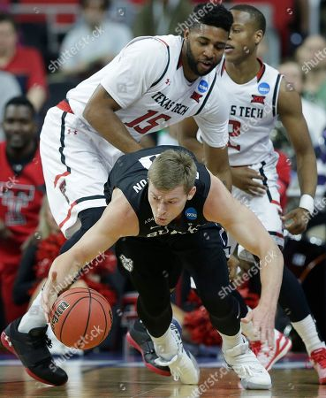 Butler forward Austin Etherington (0) moves past Texas Tech forward Aaron Ross (15) during a first-round men's college basketball game in the NCAA Tournament, in Raleigh, N.C