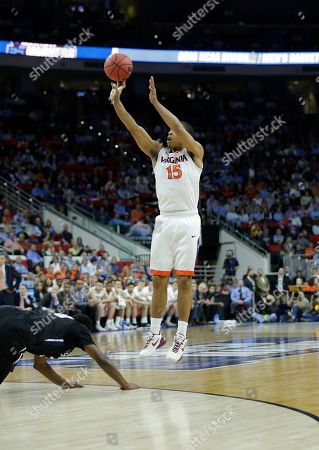Virginia guard Malcolm Brogdon (15) shoots a three point shot against Butler during the first half of a second-round men's college basketball game in the NCAA Tournament, in Raleigh, N.C