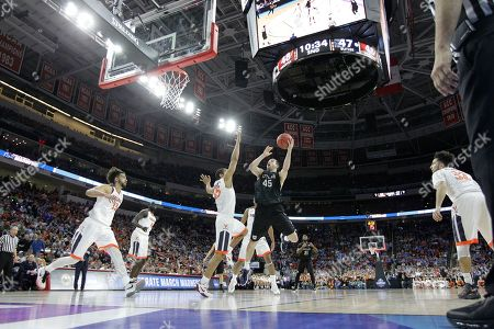 Butler forward Andrew Chrabascz (45) shoots against Virginia guard Malcolm Brogdon (15) during the second half of a second-round men's college basketball game in the NCAA Tournament, in Raleigh, N.C. Virginia won 77-69