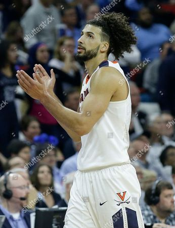 Virginia guard Malcolm Brogdon (15) celebrates near the end of the second half of a second-round men's college basketball game in the NCAA Tournament against Butler, in Raleigh, N.C. Virginia won 77-69