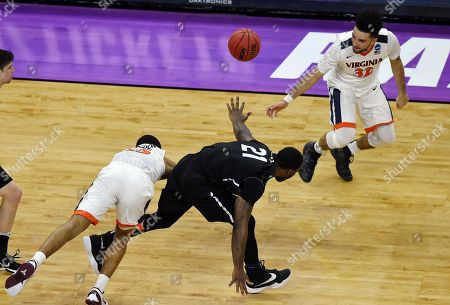 Virginia guard Malcolm Brogdon (15) and Butler forward Roosevelt Jones (21) collide during the second half of a second-round men's college basketball game in the NCAA Tournament, in Raleigh, N.C. Virginia won 77-69