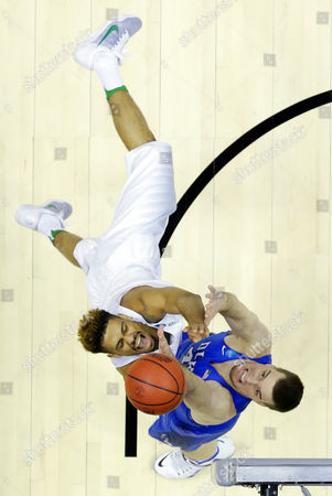 Oregon guard Tyler Dorsey, left, shoots over Duke center Marshall Plumlee during the first half of an NCAA college basketball game in the regional semifinals of the NCAA Tournament, in Anaheim, Calif