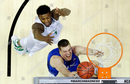 Duke center Marshall Plumlee, bottom, shoots past Oregon forward Jordan Bell during the second half of an NCAA college basketball game in the regional semifinals of the NCAA Tournament, in Anaheim, Calif