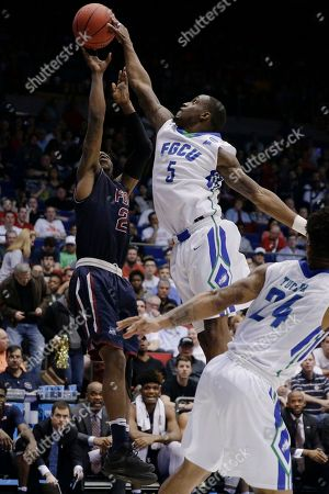 Zach Johnson, Earl Potts Jr Florida Gulf Coast's Zach Johnson (5) blocks a shot by Fairleigh Dickinson's Darian Anderson (2) in the second half of a First Four game of the NCAA college basketball tournament, in Dayton, Ohio