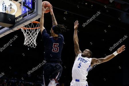 Earl Potts Jr., Zach Johnson Fairleigh Dickinson's Earl Potts Jr., left, dunks on Florida Gulf Coast's Zach Johnson, right, in the second half of a First Four game of the NCAA college basketball tournament, in Dayton, Ohio