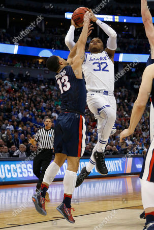 Stock Image of Derrick Gordon, Josh Perkins Seton Hall guard Derrick Gordon goes up for a shot over Gonzaga guard Josh Perkins during the first half of a first-round game, in the NCAA men's college basketball tournament in Denver