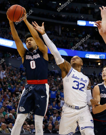 Stock Image of Silas Melson, Derrick Gordon Gonzaga guard Silas Melson, left, pulls in a rebound as Seton Hall guard Derrick Gordon reaches for it during the first half of a first-round game, in the NCAA men's college basketball tournament in Denver