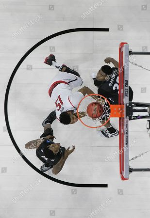 Texas Tech forward Aaron Ross (15) shoots against Butler forward Kelan Martin (30)during the first half of a first-round men's college basketball game in the NCAA Tournament, in Raleigh, N.C. Butler won 71-61