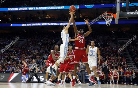 Marcus Paige, Thomas Bryant North Carolina's Marcus Paige, left, releases a shot against Indiana's Thomas Bryant during the first half of an NCAA college basketball game in the regional semifinals of the men's NCAA Tournament, in Philadelphia