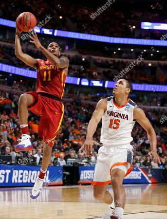 Monte Morris, Malcolm Brogdon Iowa State's Monte Morris (11) goes up for a shot against Virginia's Malcolm Brogdon (15) during the second half of a college basketball game in the regional semifinals of the NCAA Tournament, in Chicago