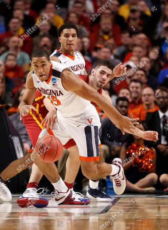 Malcolm Brogdon, Georges Niang Virginia's Malcolm Brogdon (15) steals a ball from Iowa State's Georges Niang (31) during the first half of a college basketball game in the regional semifinals of the NCAA Tournament, in Chicago