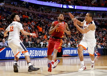 Monte Morris, London Perrantes, Malcolm Brogdon Iowa State's Monte Morris (11) drives against Virginia's London Perrantes (32) and Malcolm Brogdon (15) during the second half of a college basketball game in the regional semifinals of the NCAA Tournament, in Chicago