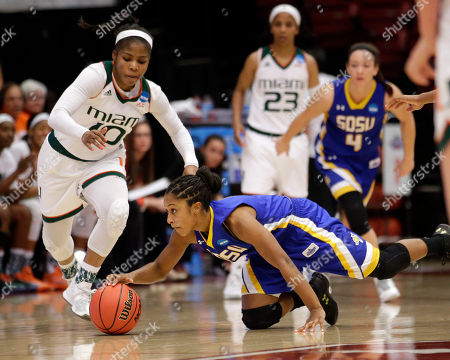 Michelle Woods, Alexis Alexander South Dakota State guard Alexis Alexander, bottom, battles for a loose ball against Miami guard Michelle Woods (10) in the second half of a first-round women's college basketball game in the NCAA Tournament, in Stanford, Calif. South Dakota State won 74-71