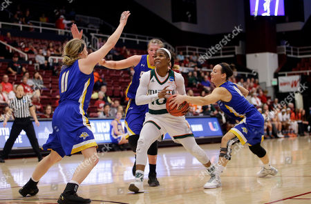 Michelle Woods Miami guard Michelle Woods, center, drives to the basket against South Dakota State in the first half of a first-round women's college basketball game in the NCAA Tournament, in Stanford, Calif