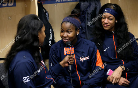 Taylor Ford, Alexis Peterson Syracuse guard Alexis Peterson, center, is interviewed by teammate Taylor Ford, left, in the locker room ahead of a regional final women's college basketball game in the NCAA Tournament, in Sioux Falls, S.D. Syracuse will play Tennessee on Sunday