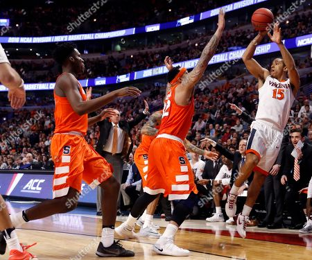 Malcolm Brogdon Virginia's Malcolm Brogdon (15) attempts a three point basket during the first half of a college basketball game against Syracuse in the regional finals of the NCAA Tournament, in Chicago