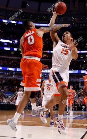 Malcolm Brogdon, Michael Gbinije Virginia's Malcolm Brogdon (15) shoots over Syracuse's Michael Gbinije (0) during the first half of a college basketball game in the regional finals of the NCAA Tournament, in Chicago