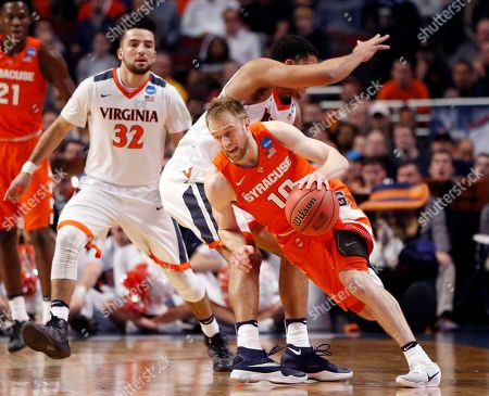 Trevor Cooney, Malcolm Brogdon Syracuse's Trevor Cooney (10) drives past Virginia's Malcolm Brogdon (15) during the first half of a college basketball game in the regional finals of the NCAA Tournament, in Chicago
