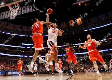Malcolm Brogdon, Michael Gbinije Virginia's Malcolm Brogdon (15) drives to the basket against Syracuse's Michael Gbinije (0) during the first half of a college basketball game in the regional finals of the NCAA Tournament, in Chicago