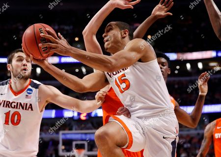Malcolm Brogdon Virginia's Malcolm Brogdon (15) goes up for a shot against Syracuse defense during the first half of a college basketball game in the regional finals of the NCAA Tournament, in Chicago