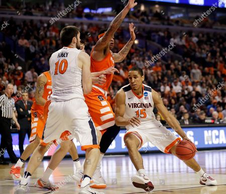 Malcolm Brogdon, DaJuan Coleman Virginia's Malcolm Brogdon (15) drives against Syracuse's DaJuan Coleman (32) during the second half of a college basketball game in the regional finals of the NCAA Tournament, in Chicago