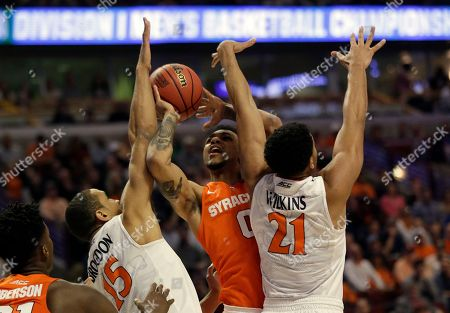 Michael Gbinije, Malcolm Brogdon, Isaiah Wilkins Syracuse's Michael Gbinije (0) attempt to shoot between Virginia's Malcolm Brogdon (15) and Isaiah Wilkins (21) during the first half of a college basketball game in the regional finals of the NCAA Tournament, in Chicago