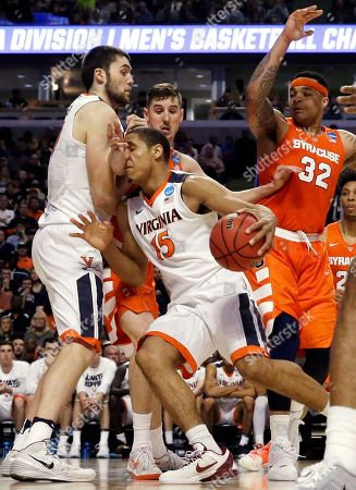 Malcolm Brogdon, Tyler Lydon Virginia's Malcolm Brogdon (15) drives against Syracuse's Tyler Lydon during the second half of a college basketball game in the regional finals of the NCAA Tournament, in Chicago