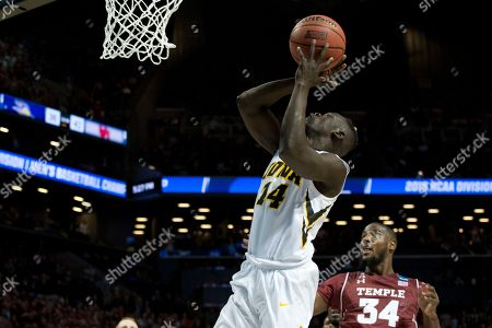 Peter Jok, Devin Coleman Iowa guard Peter Jok (14) goes to the basket past Temple guard Devin Coleman (34) during overtime of a first round men's college basketball game in the NCAA Tournament, in New York. Iowa won 72-70 in overtime