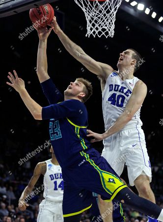Marshall Plumlee, C.J. Gettys Duke center Marshall Plumlee (40) blocks a shot by North Carolina-Wilmington center C.J. Gettys (23) in the second half during the first round of the NCAA college men's basketball tournament in Providence, R.I., . Duke won 93-85