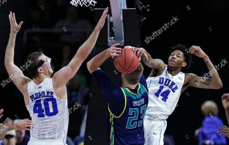 Brandon Ingram, Marshall Plumlee, C.J. Gettys Duke guard Brandon Ingram (14) and center Marshall Plumlee (40) double team North Carolina-Wilmington center C.J. Gettys (23) and block his drive to the basket in the first half during the first round of the NCAA college men's basketball tournament in Providence, R.I
