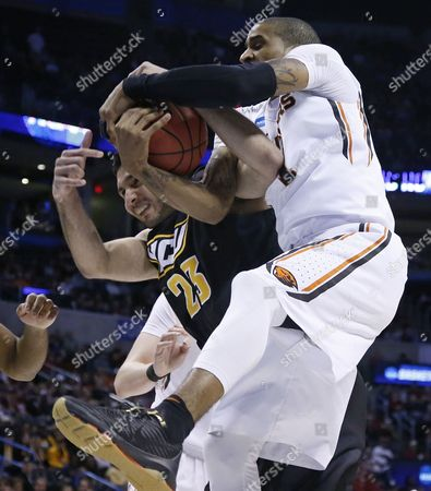 Ahmed Hamdy-Mohamed, Gary Payton II Virginia Commonwealth forward Ahmed Hamdy-Mohamed (23) and Oregon State guard Gary Payton II, right, fight for control of a rebound in the second half of a first-round men's college basketball game in the NCAA Tournament, in Oklahoma City. VCU won 75-67