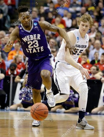 J.P. Macura, Richaud Gittens Weber State's Richaud Gittens, left, and Xavier's J.P. Macura chase a loose ball during the first half in a first-round men's college basketball game in the NCAA tournament, in St. Louis