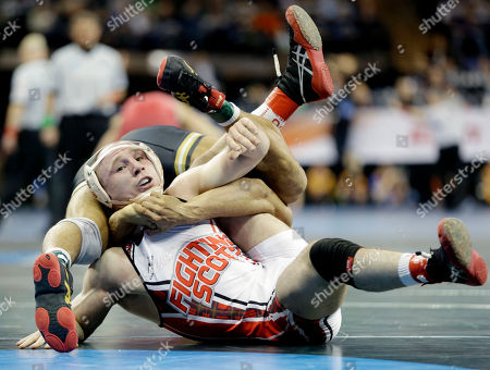 Casey Fuller Edinboro's Casey Fuller, left, is pinned by Missouri's Daniel Lewis in a 165-pound match during the NCAA Division 1 wrestling championship in New York