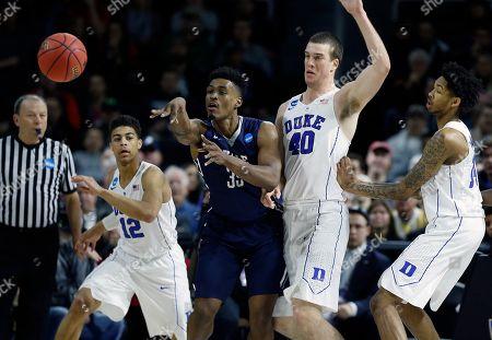 Brandon Sherrod, Marshall Plumlee Yale's Brandon Sherrod (35) passes off in front of Duke's Marshall Plumlee (40) during the second half in the second round of the NCAA men's college basketball tournament in Providence, R.I., . Duke won 71-64