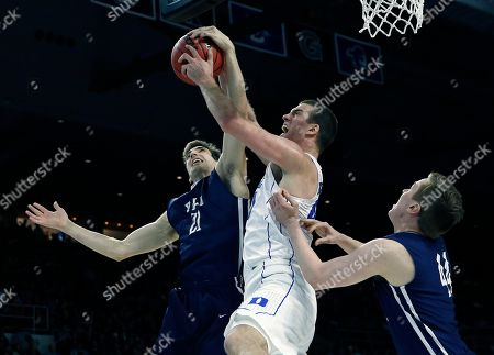 Marshall Plumlee, Nick Victor Duke's Marshall Plumlee, center, and Yale's Nick Victor (21) battle for a rebound during the second half in the second round of the NCAA men's college basketball tournament in Providence, R.I., . Duke won 71-64